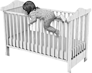 Small child trying to climb out of their cot.